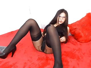 Girl in layered black pantyhose and stockings striptease
